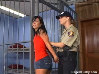 Skinny dark haired chick gets searched and locked up