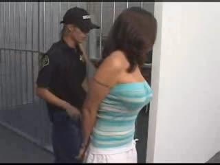 Busty brunette gets locked up