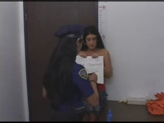 Dark haired chick stripped and searched by sexy female officer