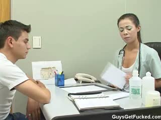Doctor examines her patient dick