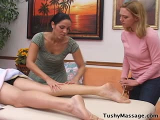 Woman Teaches another Girl how to Massage A Guy